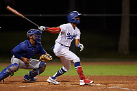 AZL Dodgers Mota Albert Suarez (63) at bat in front of catcher Reynaldo Pichardo (6) during an Arizona League game against the AZL Rangers at Camelback Ranch on June 18, 2019 in Glendale, Arizona. AZL Dodgers Mota defeated AZL Rangers 13-4. (Zachary Lucy/Four Seam Images)