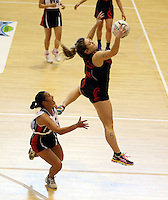 29.09.2014 Eastern Waikato's Nicole Foster in action during the Counties Manukau v Eastern Waikato duing the Lion Foundation Netball Champs at the Trusts Stadium in Auckland. Mandatory Photo Credit ©Michael Bradley.