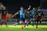 Stephen McGinn of Wycombe Wanderers takes a shot at goal during the The Checkatrade Trophy Southern Group D match between Wycombe Wanderers and Coventry City at Adams Park, High Wycombe, England on 9 November 2016. Photo by Andy Rowland.