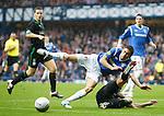 Alejandro Bedoya is tackles by Ian Murray