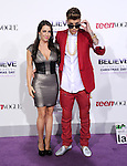 LOS ANGELES, CA - December 18: Justin Bieber and mom arrives at Justin Bieber`s Believe World Premiere held at The Premiere House at Regal Cinemas L.A. Live in Los Angeles, California on December 18,2013                                                                               © 2013 Hollywood Press Agency