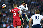 Dele Alli of Tottenham Hotspur is challenged by Alfie Mawson of Swansea City during the premier league match at the Wembley Stadium, London. Picture date 16th September 2017. Picture credit should read: Robin Parker/Sportimage