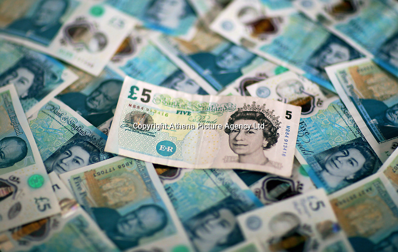 An old £5 note resting on a bed of new ones<br />Re: The £5 banknote, featuring prison reformer Elizabeth Fry, will lose their legal tender status on Friday 05 May 2017.<br />Around 150 million of the notes remain in circulation.