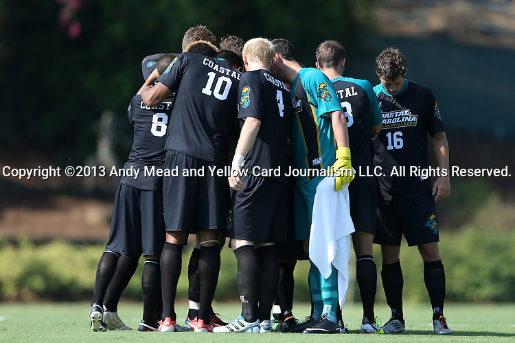 02 September 2013: Coastal Carolina's starters huddle before the game. The University of North Carolina Tar Heels hosted the Coastal Carolina University Chanticleers at Fetzer Field in Chapel Hill, NC in a 2013 NCAA Division I Men's Soccer match. UNC won the game 4-0.