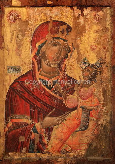 Icon of St Mary Heleusa, Virgin and Child, 16th century, from the Church of Saints Constantine and Helen, now housed in the National Onufri Museum in the Cathedral of the Virgin Mary inside Berat Castle or Kalaja e Beratit, in Berat, South-Central Albania, capital of the District of Berat and the County of Berat. The cathedral was built in 1797 on the foundations of an older church and its museum is named after Onufri or Onouphrios of Neokastro, Albania's famous 16th century icon painter. The museum comprises the main nave, the altar area, and several rooms in the North and West of the church. Picture by Manuel Cohen