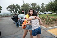 From New York City, Esmé Epstein '21 and her parents Eric and Michelle.  Incoming first-years and their families are welcomed by O-Team members and the community at the start of Occidental College's Fall Orientation for the class of 2021, Aug. 24, 2017.<br /> (Photo by Marc Campos, Occidental College Photographer)