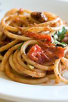 Detail of a dish of fresh spaghetti with pomodorino piennolo del Vesuvio tomato sauce