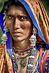 MIR nomadic tribeswoman of Gujarat,wearing traditional jewelry and bright colored clothes with veils over their head, Dasada, Rann of Kutch, Gujarat, India, portrait, colourful, silver jewellery