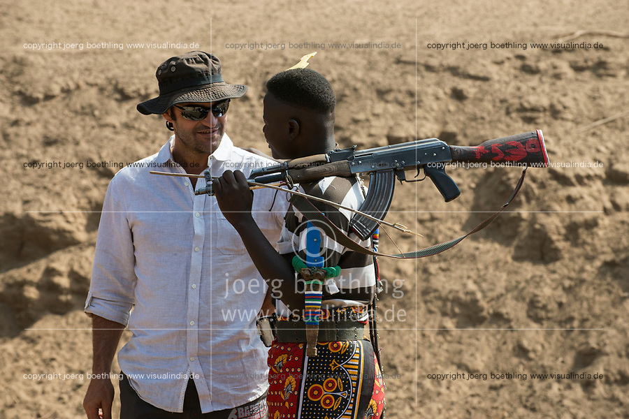 ETHIOPIA, Southern Nations, Lower Omo valley, Kangaten, village Kakuta, Nyangatom tribe, missonaries of St. Paul, Nyangatom catholic mission , spanish missionary and armed warrior