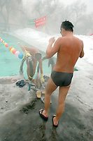 A group of Chinese men in Urumqi, the captial city of the Xinjiang Uyghur Autonomous Region, rutinely gather at a local outdoor pool to swim on bitterly cold days. I have no idea why.