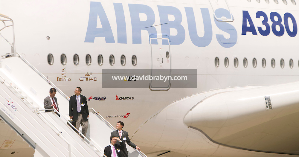 Visitors walk down an access staircase from an Airbus A380 standing on display at the Le Bourget airfield near Paris, France, after taking a tour during the first professionals-only day of the International Paris Air Show, 18 June 2007.