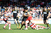Richard Haughton of London Wasps is tackled during the Aviva Premiership match between London Wasps and Gloucester Rugby at Adams Park on Sunday 1st April 2012 (Photo by Rob Munro)