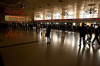Daytime landscape view of people standing in the ticket area in the B?ij?ng Zhàn in D?ngchéng Q? in Beijing.  © LAN