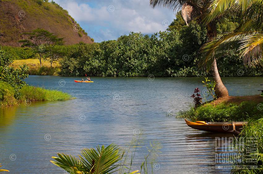 Kayakers enjoying the Wailua River, Kauai.