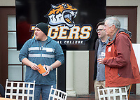 From left, Brad Turek '96 M'98, VP for Institutional Advancement Charlie Cardillo and Loren Brodhead '59.<br /> Occidental College alumni, staff and other members of the Oxy community gather in support of the football program, March 10, 2018 on Branca Patio.<br /> In January 2018 a 16-member task force of trustees, faculty, students, staff and alumni met to determine the fate of the football program in the wake of the premature end of the 2017 season. The College is moving full speed ahead with preparations for the 2018 season, led by the Football Action Team.<br /> (Photo by Marc Campos, Occidental College Photographer)