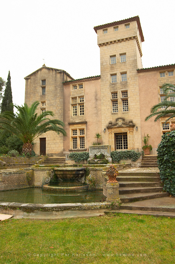 Chateau St Martin de la Garrigue. Languedoc. In the garden. France. Europe. View of the mixed architectural style building with fountain.