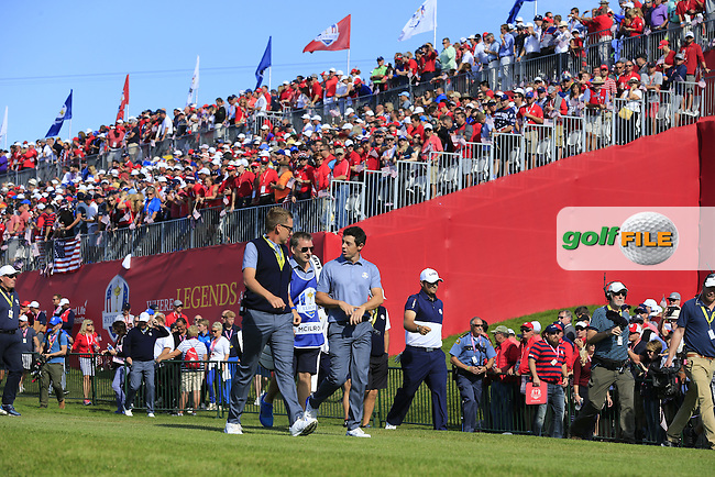 Rory McIlroy (NIR) Team Europe) talking to Vice Captain Ian Poulter during Sunday Singles matches at the Ryder Cup, Hazeltine National Golf Club, Chaska, Minnesota, USA.  02/10/2016<br /> Picture: Golffile | Fran Caffrey<br /> <br /> <br /> All photo usage must carry mandatory copyright credit (&copy; Golffile | Fran Caffrey)