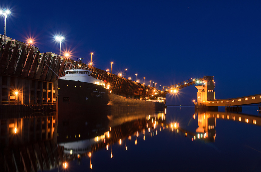 The 690-foot Herbert C. Jackson freighter unloading coal  on a clear night at the Upper Harbor dock in Marquette, MI.