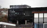Pictured: Smoke comes out of Gower College Swansea in the Tycoch area of Swansea, Wales, UK. Friday 28 October 2016<br />Re: About 100 firefighters have been tackling a large fire at Gower College Swansea.<br />Mid and West Wales Fire Service was called to Gower College on Tycoch Road, Sketty, just before 4:30am on Friday.<br />It said the fire covered the second and third floors of a four-storey building but it is now under control.<br />There were about 20 fire appliances at the scene, the incident is ongoing and Tycoch Road is shut.