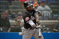 Miami Marlins Jose Reyes swings his bat during their game against New York Mets at Citi Field Stadium in New York. Photo by Eduardo Munoz Alvarez / VIEW.