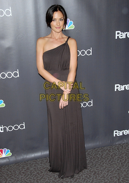 "MINKA KELLY .at the NBC Universal's ""Parenthood"" Premiere Screening held at The DGA in West Hollywood, California, USA..February 22nd, 2010                      .full length dress brown one shoulder maxi.CAP/RKE/DVS.©DVS/RockinExposures/Capital Pictures."