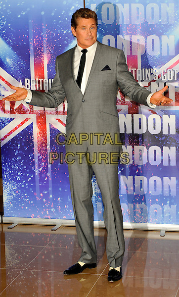 DAVID HASSELHOFF.The Britain's Got Talent new series launch photocall, Mayfair Hotel, London, England..April 13th, 2011.BGT full length white shirt black tie grey gray suit hands arms two tone shoes .CAP/CJ.©Chris Joseph/Capital Pictures.