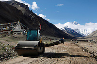 China started building a controversial 67-mile &quot;paved highway fenced with undulating guardrails&quot; to Mount Qomolangma, known in the west as Mount Everest, to help facilitate next year's Olympic Games torch relay./// A steamroller sits outside Rongbuk Monastery  on the road to Everest Base Camp.<br /> Tibet, China<br /> July, 2007