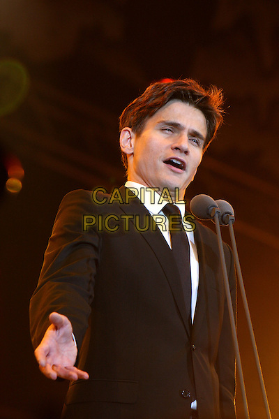 GARDAR THOR CORTES.The BBC Proms In The Park at Hyde Park, London, England..September 12th, 2009.stage concert live gig performance music half length black suit jacket microphone singing .CAP/MAR.© Martin Harris/Capital Pictures.