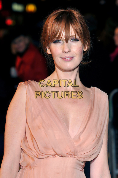 "KELLY REILLY .Attending the World Premiere of ""Sherlock Holmes"", Empire cinema Leicester Square, London, England, UK, .December 14th 2009..arrivals half length peach beige nude dress sleeveless low cut fringe .CAP/PL.©Phil Loftus/Capital Pictures."