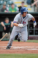 Greg Miclat (2) of the Round Rock Express heads toward first base after a hit a during the Pacific Coast League game against the Oklahoma City RedHawks at Chickashaw Bricktown Ballpark on June 14, 2013 in Oklahoma City ,Oklahoma.  (William Purnell/Four Seam Images)