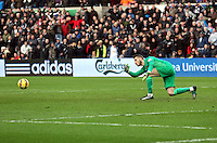 SWANSEA, WALES - FEBRUARY 21: Goalkeeper David De Gea of Manchester gives the ball to one of hies team mates during the Barclays Premier League match between Swansea City and Manchester United at Liberty Stadium on February 21, 2015 in Swansea, Wales.