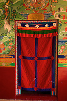 Art in Buddhist Monastery architecture in Sikkim, India - hand crafted and painted entrance