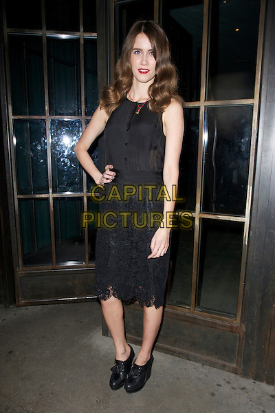 Sunday Girl aka Jade Williams.The InStyle Best Of British Talent party, Shoreditch House, Ebor St., London, England..January 26th, 2012.full length black sleeveless dress hand on hip ankle boots shoes lace .CAP/PP/CB.©Cliff Bass/People Press/Capital Pictures