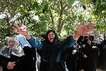 Palestinian women react during the funeral of Hamas militant Abdallah Al Qarra in Khan Younis, southern Gaza Strip, Friday, April 8, 2011. Israeli aircraft and ground forces struck Gaza on Friday in a surge of deadly fighting sparked by a Palestinian rocket attack on an Israeli school bus the day before. Just over two years after rocket fire from Gaza drew a devastating Israeli incursion in the territory, Israel and Gaza's Hamas rulers seemed poised on the brink of another round of intense violence. Photo by Mohammed Othman