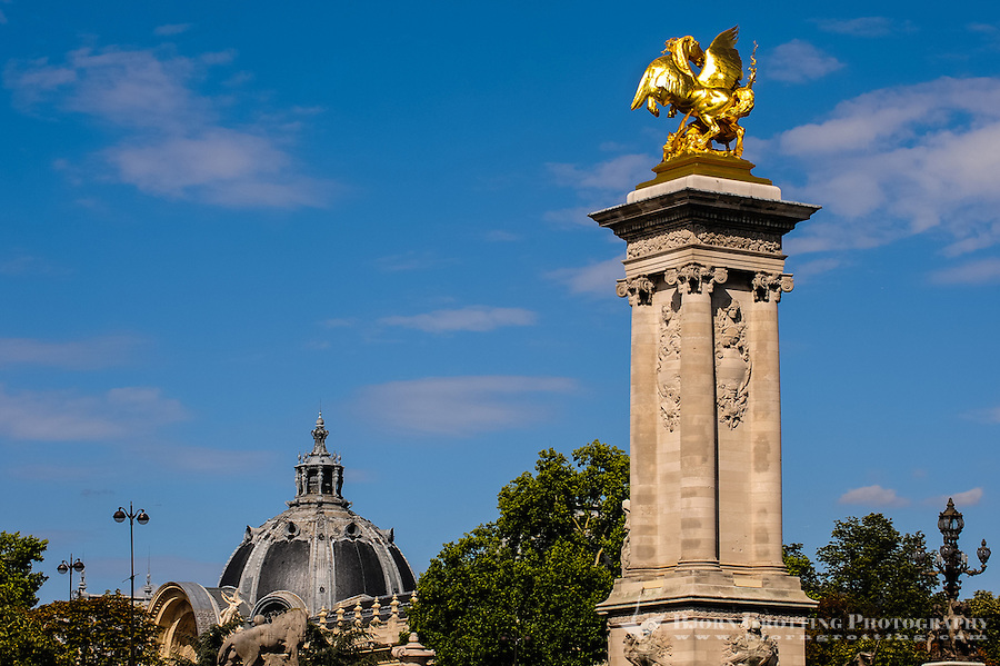 Paris, France. View from a boat on the river Seine. The Pont Alexandre III is an arch bridge regarded as the most ornate bridge in Paris. Grand Palais in the background.