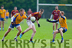 Darragh Joy Duagh is closely marked by Beauforts Nathan Sheehan and Padraig O'Sullivanduring their Junior Championship quarter final in Beaufort on Saturday