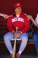 SAN FRANCISCO, CA - Manager Pete Rose of the Cincinnati Reds talks with the media in the dugout before a game against the San Francisco Giants at Candlestick Park in San Francisco, California on June 18, 1987. (Photo by Brad Mangin)
