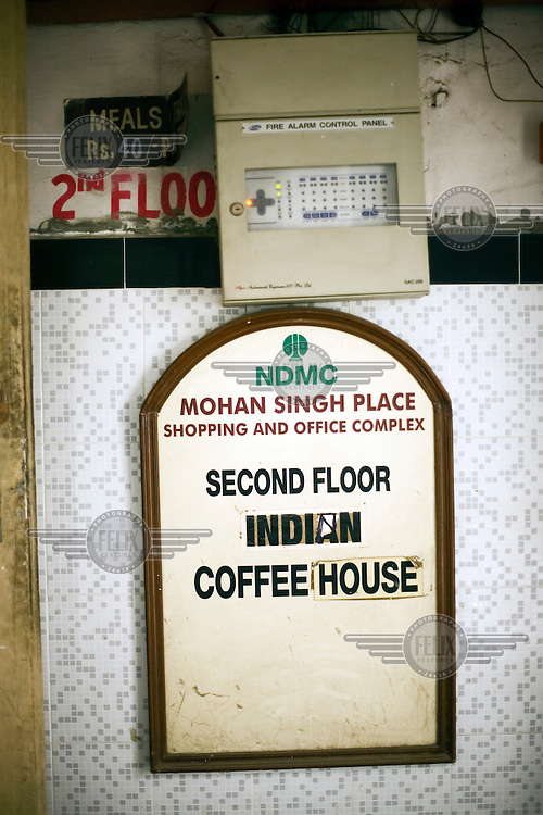 A sign for the Indian coffee house, Baba Kharak Singh Marg. The coffee house dates back almost fifty years, first in central Connaught Place, then Janpath and now at the top of a rather shabby shopping centre. Where it is still run by the Indian Coffee Workers Cooperative Society. Once a regular haunt for politicos in Delhi, its clientele is still renowned for being well-read and intellectual.