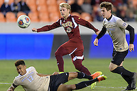 Houston, TX - Friday December 9, 2016: Alex Underwood (23) of the Denver Pioneers attempts to gain control of a loose ball in the first half against the Wake Forest Demon Deacons at the  NCAA Men's Soccer Semifinals at BBVA Compass Stadium.