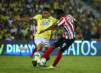 BUCARAMANGA-COLOMBIA, 07-03-2020: Nicolas Roa de Atletico Bucaramanga y Luis Gonzalez de Atletico Junior disputan el balon, durante partido entre Atletico Bucaramanga y Atletico Junior, de la fecha 8 por la Liga BetPlay DIMAYOR I 2020, jugado en el estadio Alfonso Lopez de la ciudad de Bucaramanga. / Nicolas Roa of Atletico Bucaramanga and Luis Gonzalez of Atletico Junior vie for the ball during a match between Atletico Bucaramanga and Atletico Junior, of the 8th date for the BetPlay DIMAYOR I Legauje 2020 at the Alfonso Lopez stadium in Bucaramanga city. / Photo: VizzorImage / Jaime Moreno / Cont.