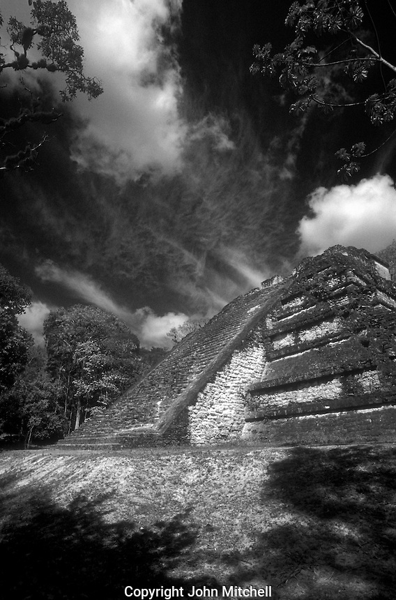 The Temple of Tablud Tablero in the Mundo Perdido or Lost World complex at the Mayan ruins of Tikal in Tikal National Park, El Peten, Guatemala