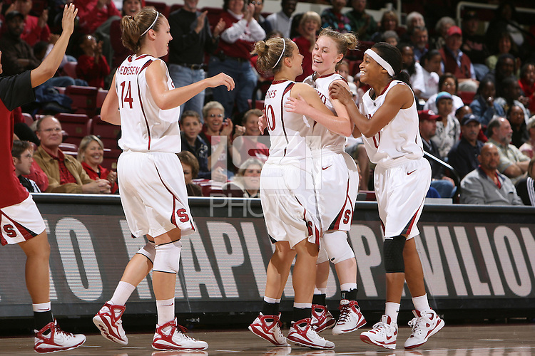 STANFORD, CA - NOVEMBER 1:  Lindy La Rocque of the Stanford Cardinal is congratulated by Kayle Pedersen #14, JJ Hones #10, and Melanie Murphy during Stanford's 123-39 exhibition win against Chico State on November 1, 2008 at Maples Pavilion in Stanford, California.