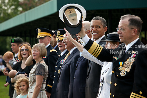 United States President Barack Obama participates in the Armed Forces farewell tribute to Admiral Mike Mullen, Chairman of the Joint Chiefs of Staff, right, at Joint Base Myer-Henderson Hall, in Arlington, Virginia, September 30, 2011. .Mandatory Credit: Pete Souza - White House via CNP
