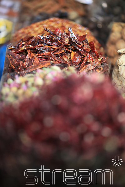 Dried chillies and spices on display in a market.