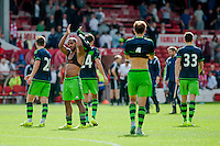 NOTTINGHAM, ENGLAND - JULY 25:  Swansea City players applaud the fans after the pre season friendly match between Nottingham Forest and Swansea City at The City Ground on July 25, 2015 in Nottingham, England.  (Photo by Aled Llywelyn / Athena Pictures )