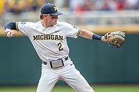Michigan Wolverines shortstop Jack Blomgren (2) makes a throw to first base during Game 11 of the NCAA College World Series against the Texas Tech Red Raiders on June 21, 2019 at TD Ameritrade Park in Omaha, Nebraska. Michigan defeated Texas Tech 15-3 and is headed to the CWS Finals. (Andrew Woolley/Four Seam Images)