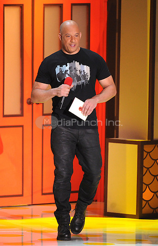 LOS ANGELES, CA - APRIL 12: Vin Diesel presents the award for Best Female Performance on the 2015 MTV Movie Awards at the Nokia Theatre LA Live on April 12, 2015 in Los Angeles, California. FMPG/MediaPunch