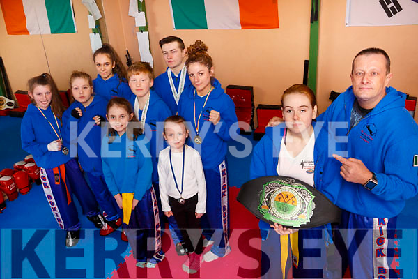 Nicole O&rsquo;Sullivan who became Grand Champion at the recent Best of the Best Championships in Kildare with her instructor Steve O&rsquo;Connor of White Panther Martial Art, Tralee.<br /> In the back l to r: Katelyn Moore, Edel O&rsquo;Connor, Rachael O&rsquo;Connor, Ellie O&rsquo;Brien, Victoria Fitzgerald, Zack O&rsquo;Connor, Luke O&rsquo;Connor, Joanna Conlon and all collected Silver medals at the same event.