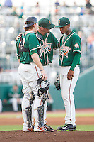 Greensboro Grasshoppers pitching coach Jeremy Powell (center) has a chat on the mound with starting pitcher Jarlin Garcia (33) and catcher Chad Wallach (47) during the game against the Hagerstown Suns at NewBridge Bank Park on June 21, 2014 in Greensboro, North Carolina.  The Grasshoppers defeated the Suns 8-4. (Brian Westerholt/Four Seam Images)