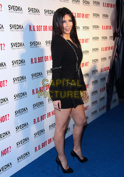 "KIM KARDASHIAN  .SVEDKA Vodka's "" R.U. Bot or Not?"" Battle of the Bots held  at  Wonderland, Los Angeles, California, USA..May 22nd, 2010.full length side black dress jacket shoes gold stud trim.CAP/ADM/TC.©T. Conrad/AdMedia/Capital Pictures."
